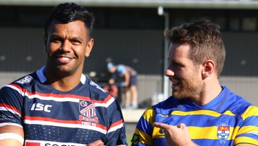 Banter: Kurtley Beale and Bernard Foley wearing their club colours at Waratahs training.