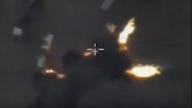 A Syrian government image showing an air strike on oil trucks in Aleppo in 2015.