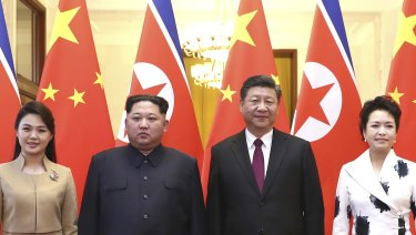 Chinese President Xi Jinping, second from right, and his wife Peng Liyuan, right, and North Korean leader Kim Jong-un and his wife Ri Sol-ju, at the Great Hall of the People in Beijing.