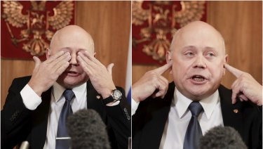Russian Ambassador Grigory Logvinov gestures to reporters during a lengthy press conference in Canberra.