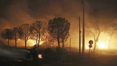 Buildings burn in the town of Mati.