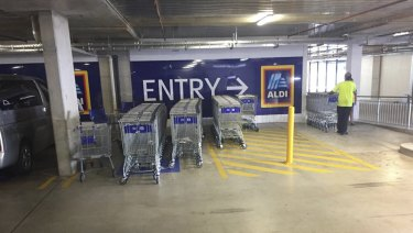 Trollies stored in a disabled parking space at Aldi at Glenmore Park Town Centre this month.