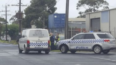 Police investigate after the discovery of a body in a car in Geelong.