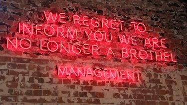 The tongue-in-cheek neon sign above the bar at Les Bubbles.