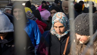 Migrants wait to be allowed to cross the border from Slovenia, in Spielfeld, into Austria in 2016.