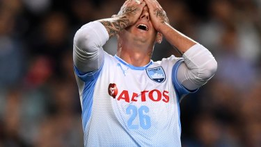 Luke Wilkshire reacts after missing a golden chance.
