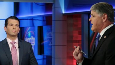 Donald Trump Jr., left, appeared on Sean Hannity's Fox News program on Tuesday.