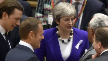 British Prime Minister Theresa May, centre, speaks with from left, Austrian Chancellor Sebastian Kurz, European Council President Donald Tusk, Swedish Prime Minister Stefan Lofven and Portuguese Prime Minister Antonio Costa in Brussels on Thursday.