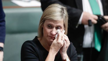 Labor MP Susan Lamb wipes away tears following her speech in the House of Representatives on Wednesday.