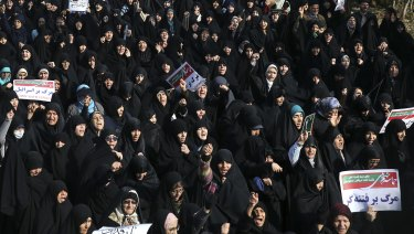 Iranian protesters chant slogans at a rally in Tehran, Iran.