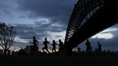 Entrants run under the Sydney Harbour Bridge in the Sydney Morning Herald half-marathon.