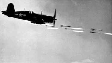 One of David Douglas Duncan photos of a Marine Corsair fighter firing rockets at a Japanese stronghold on Okinawa in June 1945.