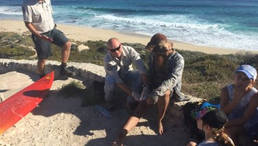 Jason Longgrass, 41, is treated by paramedics after he was bitten on his right leg at Lefties, the second shark attack in Gracetown this week.