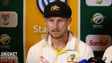 Cameron Bancroft faces the media after being charged with changing the condition of the ball.