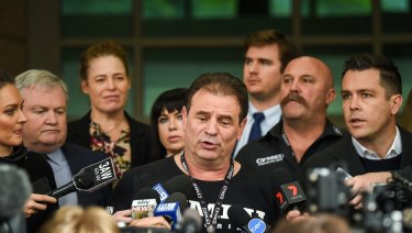 Charges against CFMMEU secretary John Setka (centre) and his deputy Shaun Reardon (second from right) were dropped on May 16.