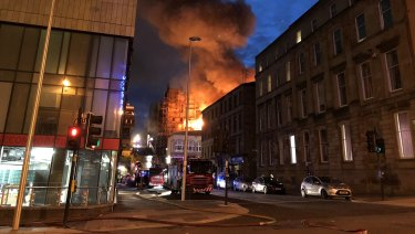 Flames and smoke rise from the Glasgow School of Art's Mackintosh Building.