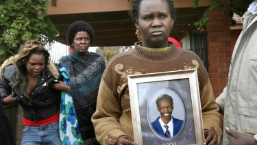 A photo of  Liep Gony is held by his mother Martha Ojulo.