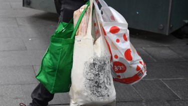 Some shoppers are embracing reusable bags.