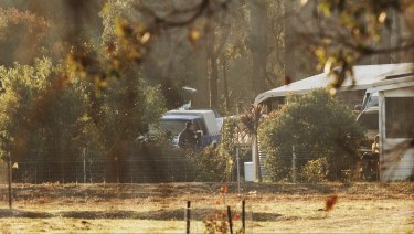 Forensic police at the property in Osmington where seven people were found shot dead.