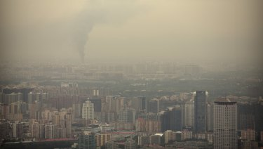 Smoke rises above Beijing on a moderately polluted day in August 2017.