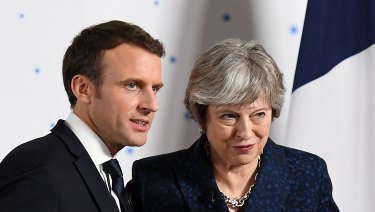 Theresa May, UK prime minister, right, and Emmanuel Macron, France's president in January.