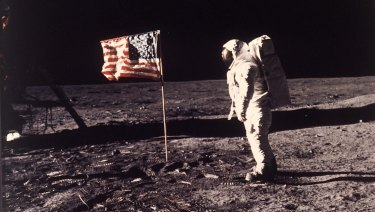 "Astronaut Edwin ""Buzz"" Aldrin poses for a photograph beside the US flag planted on the moon during the Apollo 11 mission on July 20, 1969."