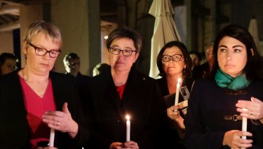 Senator Janet Rice, Senator Penny Wong, Ged Kearney and Terri Butler attend a candlelight vigil for Eurydice Dixon at Parliament House in Canberra.