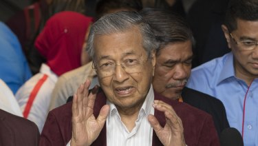 In chaotic scenes, Mahathir Mohamad told reporters that he believed his opposition alliance had won the election.