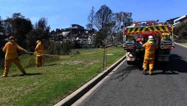 The Rural Fire Service was on scene within 15 minutes of the first triple zero calls, but declined offers for help from NSW Fire and Rescue until the fire was bearing down on Tathra's streets.