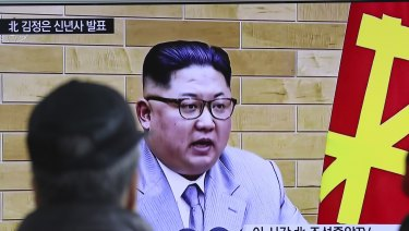 South Koreans watch a TV news program showing North Korean leader Kim Jong-un's New Year's speech.