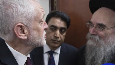 Nothing personal: Labour leader Jeremy Corbyn, left, meets locals at Finsbury Park Mosque in north London, after an incident where where a van struck pedestrians, in London, in June.