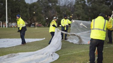 Council workers cover up graffiti painted at the memorial site of Melbourne comedian Eurydice Dixon.