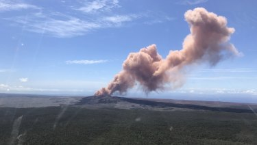Red ash rises from the Puu Oo vent on Hawaii's Kilauea Volcano after a magnitude-5.0 earthquake struck the Big Island.