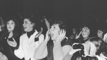 Where's Molly? Beatles fans scream as the Liverpudlians played Festival Hall in 1964.