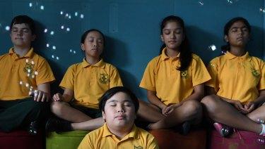 In the moment: Haris Mahmutovic, Calvin Lai, Juliet Gong, Jyonbi Acharya and Nitya Agarwal of Homebush West Public School take part in mindfulness classes.