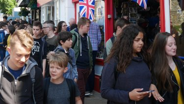 Crowds on the hunt for royal wedding souvenirs.