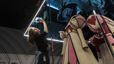 Hahna Read, project officer at ACMI, prepares an exhibit ahead of Wonderland's opening.
