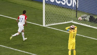 France goalkeeper Hugo Lloris reacts after Croatia's Mario Mandzukic nips in to score.