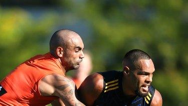 Burgoyne and Jarman Impey tussle in the pre-season