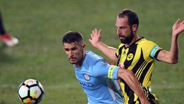 City's Dario Vidsic challenged by Andrew Durante of the Phoenix.