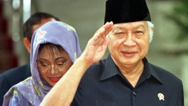 Then Indonesian president Suharto, right, salutes after announcing his resignation in 1998.