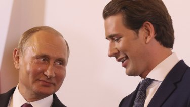 Austrian Chancellor Sebastian Kurz, right, speaks with Russian President Vladimir Putin, in Vienna, Austria on Tuesday.