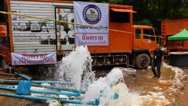 Men from the Electricity Generating Authority of Thailand overseeing the pumping of water from Tham Luang Cave.