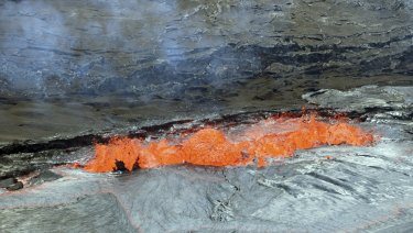 A line of spattering along a lava lake margin of the Halemaumau Crater floor, Kilauea Volcano last month.