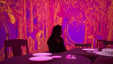 An immersive installation using projections recreates the Mad Hatter's tea party.