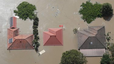 Roofs of houses were visible above flood waters west of Brisbane January 13, 2011.
