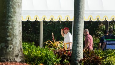 President Donald Trump, pictured at his Mar-a-Lago resort, allegedly used his charity to pay off fines the resort incurred.