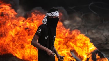 A Palestinian protester near the border with Israel in eastern Gaza City.