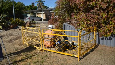 A technician installs NBN in front of a home in Wanneroo.