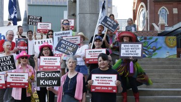 Protesters including those from Australia outside the Exxon annual general meeting in Dallas.